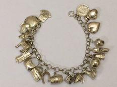 Silver charm bracelet with 19 charms