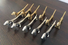 Lot of 11 Dachshund knife rests, knife holders, knife/cutlery holders, dog-shaped Dachshunds silver-plated bronze
