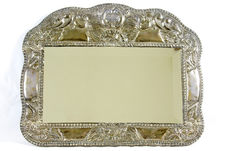 Hanging mirror with an embossed silver frame. 19th Century