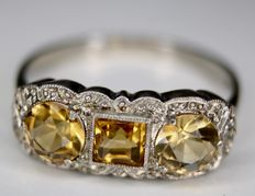 Ring circa 1920/'40 with 3 faceted Gold Citrine stones in millegraine frame, an old engagement ring.