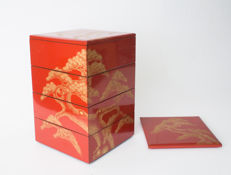 A four-piece red lacquered jubako set with two lids Beautifully decorated with gold painted pine trees – Japan – 1920–1930