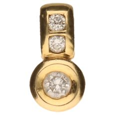 Yellow gold pendant set with three brilliant cut diamonds, one of which is 0.10 ct and two are 0.03 ct. 0.16 ct in total