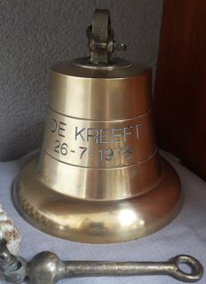 Large brass ship bell from a ship of the company Boskalis