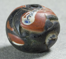 An ancient glass bead from the Islamic era