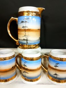 Fantastic set of hand painted German beer mugs