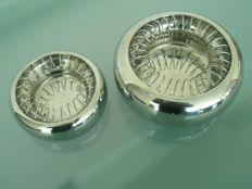 Two Alessi ashtrays in stainless steel
