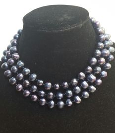 Long necklace in freshwater cultured big black round pearls