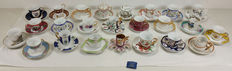 Lot of 24 hand-painted porcelain mignon cups