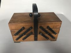Expandable wooden travel sewing box with content. (Amsterdam school style.)
