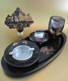 A Japanese lacquer pipe rack & smoking table lighter set