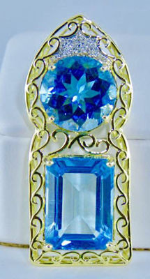 very beautiful pendant ,2 Natural Blue topaz with 0.20 ct nice diamonds and 18 kt yellow gold