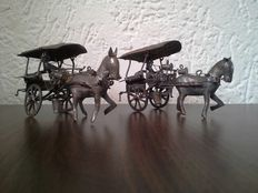 Two silver-plated miniatures, horse and carriage.