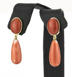 Dangle yellow gold earrings set with Pacific coral stones.