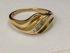 Gold ring with baguette cut diamonds