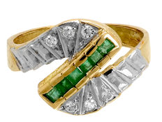 Gold ring with emeralds and zirconias