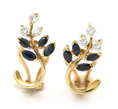 Yellow gold earrings with zirconias and marquise cut sapphires.