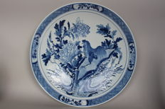 Large plate with a hen between blossoms and branches – China – most likely 19th century.