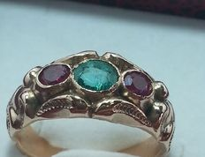 Antique ring from the 1950s with 1.20 ct emerald and 0.76 ct round cut rubies