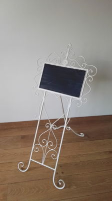 A wrought iron announcement board