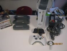 Xbox 360 with 4 - 60gb harddisc , 10 games , 2  headphone and more.