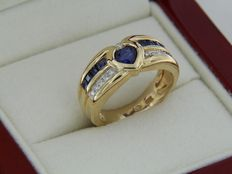 Yellow gold ring with heart-shaped sapphire and calibrated sapphires and diamonds