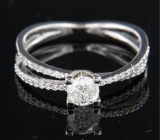14 kt white gold ring set with 0.52 carat, brilliant cut diamond and 36 diamonds, 0.18 carat, ring size: 17.5 (55)