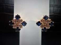 18 kt gold earrings, with light blue iolites and white sapphires.
