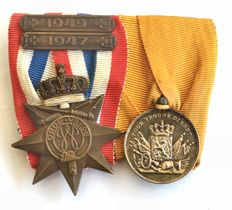 Pin of two medals of order and peace loyal service 36 years Netherlands