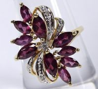 Cocktail ring 14Kt. gold with Rhodolite and small diamonds. Excellent state.