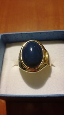 Solid yellow gold ring with cabochon cut blue agate
