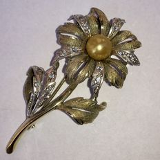 Silver and gold-plated brooch with yellow pearl and marcasite, circa 1950.