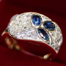 14kt. Handkrafted beautiful wide ring with fine blue Sapphires and diamonds H/SI in very good condition.