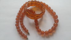 Old amber necklaces and bracelet honey/caramel colour.