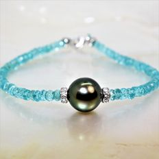 Bracelet made of 925 silver, faceted Apatite gemstones, and a black Tahitian pearl of 10 mm in diameter