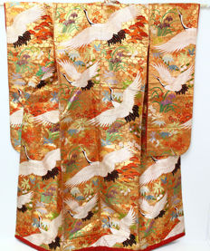 A uchikale bridal kimono, surrounded by classic designs with embroidery of cranes - Japan - second half 20th century