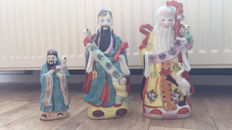 Three porcelain Chinese Bouddha's with children - China - second half of the 20th century