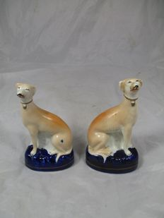 Pair of Pottery Seated Whippet Figures