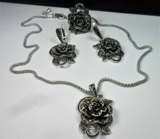 Set in silver filigree, consisting of ring, earrings, chain and pendant set with marcasites.