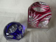 Two heavy Val Saint Lambert cut crystal paperweights in red and blue layered crystal, Belgium, 20th century