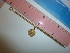 Women's bracelet with a half- pound coin set inside a ring.