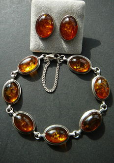 Sterling silver bracelet and ear studs with transparent amber.