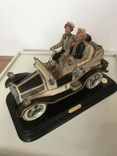 Sculptor: Guido Cortese, Maker: Cevik Capodimonte Italy, large sculpture of a romantic couple in a classic car.