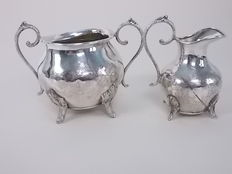 Old set in 2 Pieces, sugar bowl and creamer with three crowns, marked, in English plated silver