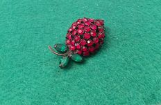 Vintage brooch signed Warner ,made from black metal and dark red and green rhinestones