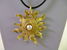 Gold pendant in the shape of the sun, 1970s
