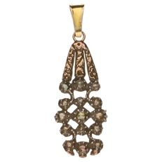 Yellow gold antique pendant with a silver setting with 15 rose cut diamonds.