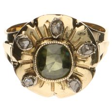 Yellow gold ring with a head set with a sapphire and 5 rose cut diamonds