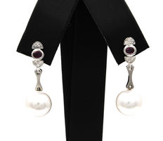 White gold earrings with brilliant cut diamonds, oval cut rubies and Australian pearls