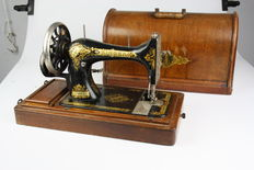Singer sewing machine with wooden lid