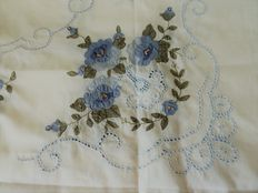 Old rectangular tablecloth - white cotton embroidered by hand a with four large blue floral patterns